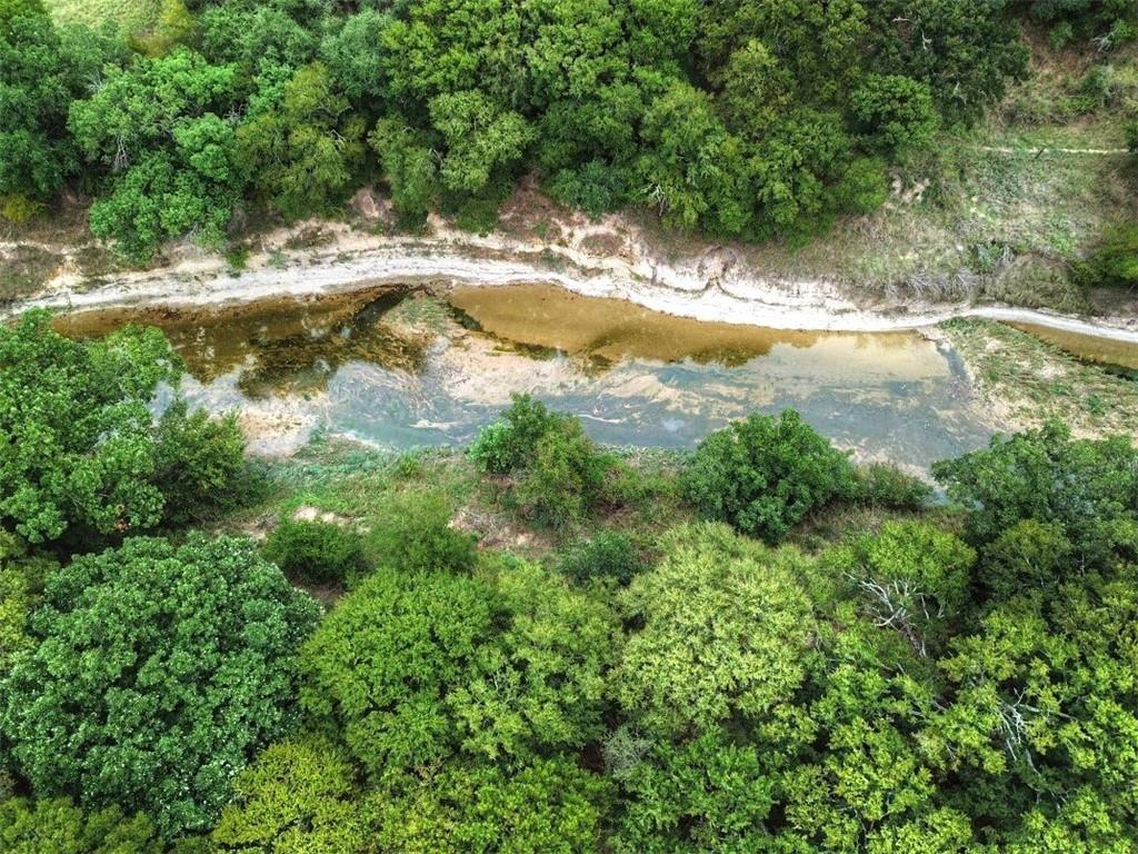 Are you looking for river frontage?  Look no further.  This property boasts more than 400 feet of the Lampasas river. Located just 18 miles from Lampasas, 2 miles north of Adamsville, the property has over 800 feet of US Highway 281 frontage. This 39.81-acre parcel has a lot of potential. The open field has a gorgeous pecan tree.  Along the river, you can find huge pecan, oak, elm and post oak trees.