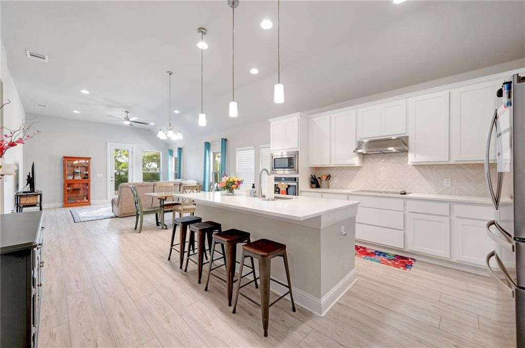 Seller job change is your advantage!  Four month old new build without the wait and uncertainty in pricing.  Bright and light and open floorplan.  If you like high ceilings, they are EVERYWHERE in this home.  Over $55K in builder upgrades included.  Dedicated study/second living area.  Primary suite also features adjoining office or exercise room.  Fully fenced and landscaped and sprinklered yard with covered back porch.  Flat and easy to use driveway.  Brand new 14ft. X 24ft. back yard patio ready for your gazebo and outdoor living and grilling.  Building superintendent verified no neighbors to be built behind the home!  Keep the view!  Ready, now, for easy living.  Great access to nature trails down to the river.  Convenient to Georgetown shopping - Target, HEB, Starbucks within 5 miles of home.