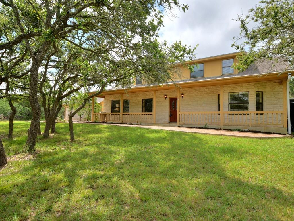 Beautiful home situated on heavily wooded 2.98 acres in Georgetown's Whitetail Subdivision! Conveniently located 15 minutes from Georgetown, Cedar Park, and Round Rock. No HOA and a low property tax rate of 1.89%. Several well-built outbuildings on this property to include an 18' x 18' metal workshop, a large carport for RV/boat/trailer, and an additional storage shed, all complete with electricity. The fully enclosed backyard has a fenced garden and a rainwater collection system. Covered front and back porches, with an extended stone patio offer many opportunities for entertaining and relaxing. The interior has many updates and upgrades, including recent paint, remodeled baths, and kitchen. Tile flooring and engineered hardwood runs throughout most of the home. Wired for security. New water softener and UV light filtration system. Kitchen features granite countertops, wood cabinetry, and plentiful storage. Glass cooktop, stainless steel built-in oven, microwave, and vent hood were all recently replaced. The flexible floor plan includes two primary bedrooms with attached full baths on the main level, in addition to a half bath off the living area. The primary bedroom features elegant touches such as engineered wood flooring, custom window shutters, and crown molding. The primary bath has dual vanities, a soaking tub, and a separate shower. A spacious walk-in closet has been upgraded to include customized storage, racks, shelving, and drawers. Upstairs has two more bedrooms and a full bath, which has been beautifully updated with granite, white painted cabinets, and a frameless glass shower. Treetop views can be enjoyed from the upstairs windows. This gorgeous home, with a flexible floor plan, storage sheds, workshop, on acreage, truly has it all!