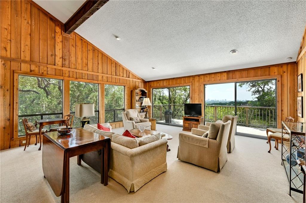 Enjoy fabulous city views at this classic 1970's Westlake home on a private, wooded lot. Immaculately maintained by the original owner. Features include open living areas, vaulted ceilings, large windows to let light in, and a large deck to take in the wooded area and city views. Exemplary Eanes ISD schools. Close to restaurants, shops, Zilker Park, and just a short drive to downtown Austin!