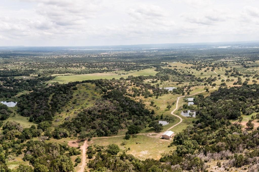 """This is a true Texas """"needle in the haystack"""": year-round spring-fed ponds, hundreds of feet of elevation, 20-mile hill top views, 3/2 barndominium, cattle pens, Century Live Oaks, natural grottoes, caverns, plus two wells, including a solar pump -- and 75% of minerals. Not hunted since 2016.  Only 12 minuets to Marble Falls amenities, an hour from Austin, and one and a half hours from San Antonio.  This ranch has everything you could want in the Texas Hill Country!"""