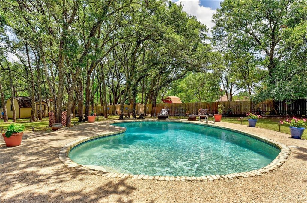 """LOCATION, CONVENIENCE AND ROOM TO ROAM!! You have just discovered your own Texas-size """"Private Oasis"""" that sits under a canopy of 94 magnificent trees on 0.78 acres AND is just minutes from The Domain, brand-new Q2 Stadium, The Arboretum and in a highly sought-after community with NO HOA!*Pre-inspected and meticulously cared for this stone 1-story, 3,943 sq.ft. 4/4/2/2+ office area was updated in 2017 & 2020 and boasts granite counters, stainless kitchen appliances, double oven, gorgeous wide plank wood floors, recessed LED lighting, central vacuum system*Huge master suite with large walk-in closet and oversized secondary bedrooms and walk-in closets*Enjoy the MASSIVE great room or teenager's retreat for hours of entertainment with family & friends w/movie theater, shuffleboard, custom granite bar & hanging glass front cabinets, fridge & wine fridge*Large 130 sq.ft. pantry with 2nd refrigerator*The Texas-size pavilion-610 sq.ft.-will provide the perfect place to also entertain by the pool on these hot summer days*Huge laundry room with sink, ample counter space and hanging rods for ease*CAT 5 and Coax wiring throughout*Huge workshop & storage shed w/electricity +2 lofts*This is a MUST SEE*"""