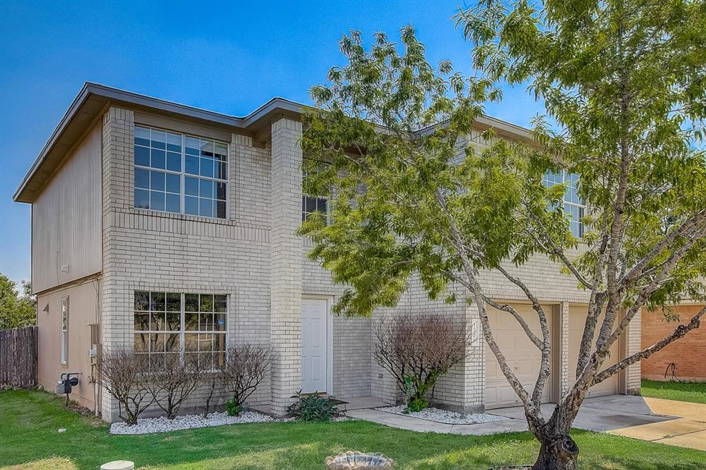 This Pflugerville two-story home offers a patio, quartz countertops, and a two-car garage.