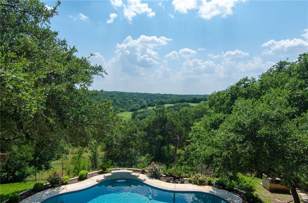 """Stunning hill country and Twin Creeks Golf Course views from this amazing home in Cedar Park's Ranch at Deer Creek neighborhood ~ expansive pool & outdoor living areas are just the beginning ~ Entertainer's Paradise ~ Chef's Kitchen with Viking 6-burner cooktop, island prep sink & tons of storage ~ Main Level Owner's Suite and Guest Suite ~ Study w/ wood floors off Entry Foyer ~ upper level Gameroom features wood floors PLUS bar, pool table, poker table & shuffle board all convey ~ Media Room w/ 100"""" projection screen, AV equipment/speakers, wet bar, wine & full-size refrigerators ~ 3-Car Garage ~ walk-out attic storage off 5th bedroom/work-out room ~ floorplan available in the images. Conveniently located less than 2 miles from all Leander ISD schools - Deer Creek Elementary, Cedar Park Middle & Cedar Park High! Don't miss this opportunity to own this gem!"""