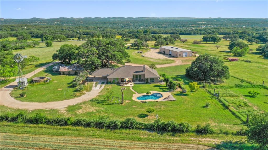 44.52 +/- Acres that is absolutely stunning!! The place has a lot to offer. The home was built in 2009 and is 2383 sq ft and offers 3 beds 2 baths and a nice swimming pool in back yard. There is a nice little guest casita that has one bedroom and a bath as well. Also on site is a 40x100 metal building and a horse shelter with 2 stalls. The access to the ranch is awesome with approx 800 ft of paved frontage on Ranch Rd 1323. The land is very usable and has awesome soils. The current owner currently makes hay on site in 2 different pastures. Great Water well on site. Fenced and cross fenced. Located less than 5 minutes to downtown Johnson City, 20 min to Marble Falls, and less than an hour to Austin and San Antonio.