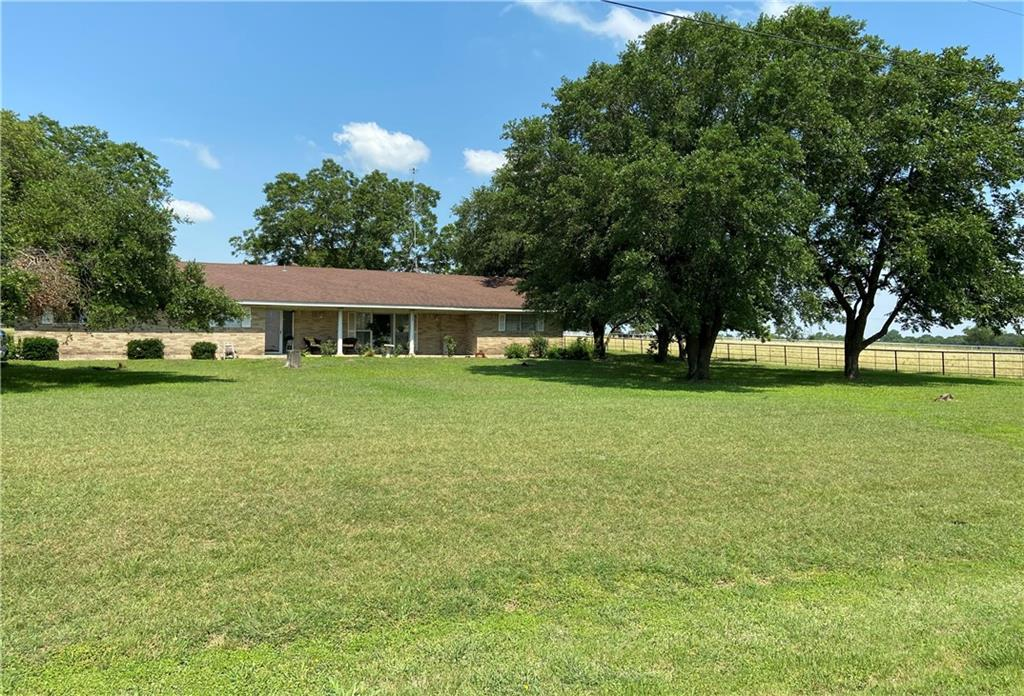 Fantastic ranch home on acreage! Location*Location*Location! Multiple shade trees! So much storage! This 3 bedroom 2 1/2 bath charmer has a flex room for an office, exercise, game room, convert to 4th bedroom or have lots of extra storage. Massive living room with windows for lots of natural light! Huge kitchen with custom cabinets, built in appliances and island with breakfast bar has room for multiple cooks! Adjacent dining room is spacious and provides a gathering space while meals are being prepared. All bedrooms are very large, can accommodate king sized furniture and have countryside views! The 2.5 car garage has garage door openers for easy access, closed storage area to lock and open storage area under window that is perfect for a work bench and hobbies! Don't miss the storage shed and large barn out back! Connected to city water with septic. Choose Temple or Academy ISD!  Country living with all the city conveniences! Short, quick, easy commute to Temple Mall, Temple College, Scott & White Hospital, Sam's, major restaurants and employers.  NO ZONING, NO RESTRICTIONS, NO HOA and NO CITY TAXES! This property brings flexible opportunities!  Have horses, chickens or beautiful gardens and organic living! Add a pool and cabana or build a secondary home for guests or rental income. Multiple building sites! Can even turn commercial or subdivide for future investments!