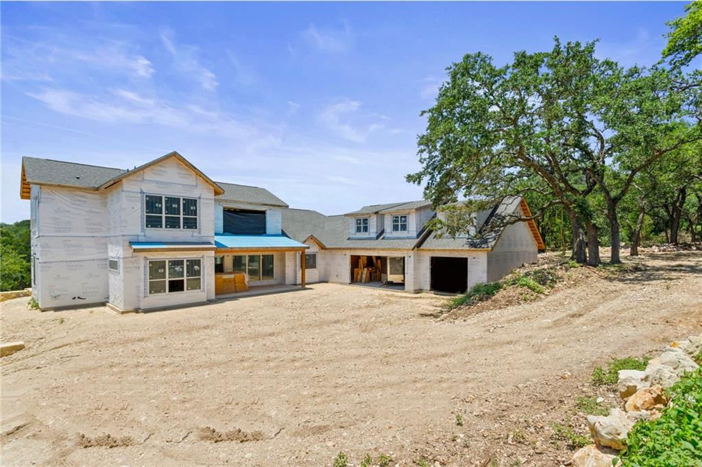 Beautiful Custom new construction estate built on 1.6 acres, in a quiet cul-de-sac in the desired Gated Gabriel's Overlook Neighborhood. Set back away from the street this spectacular home with an elevated foundation offers views from every window including views directly though the home with views of the oak grove.     The main level offers a grand living room with modern fireplace opens to the large dining room and luxurious custom kitchen complete with professional range, additional oven, oversized 44in workstation sink with dual faucets on a 12' island and separate prep sink. Right off the dining room you will find a separate game room built for entertainment or can be transformed into a second-generation living room and kitchen. The secondary bedroom downstairs is set up with an on-suite bath and walk-in closet. Tucked into the back of the home the private primary suite has a 7ft x 12ft window and a luxury bath with an oversized shower and freestanding tub. Large study with a full bath right across the hallway, pool/mud bath with outdoor entrance, laundry room with tons of built-in storage and massive drop-zone finish out the main level. Upstairs offers 3 large bedrooms, bathroom with a dual vanity, and an additional living space with walls of windows. Relax on the private covered deck is connected to the main living area and dining area with 16ft and 12ft sliding doors, fulfilling all your entertainment needs. Amazing views are capitalized on by terraced landscaping creating the perfect outdoor gathering experience. Other features include a 1,500 sqft, 6 car tandem garage and an additional 1,190 sq ft with separate heating/ac and private entrance perfect for a gym, office, shop.   Gabriel's Overlook provides homeowners a community park with private access to the San Gabriel River and is nestled between I-35 & 183A providing an easy commute to Austin. Brand new HEB and shopping center right down the road coming soon. Highly acclaimed Liberty Hill ISD.