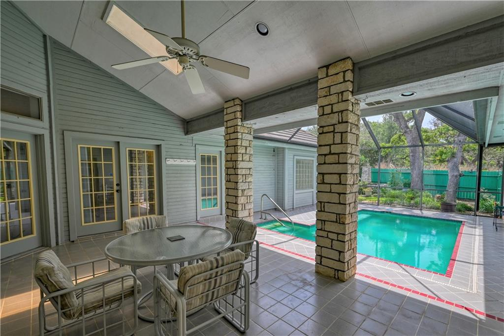 Terrific 3 bedroom, 3 bath Horseshoe Bay home with relaxing views of the private backyard pool from the living room, breakfast room, and master bedroom. The pool is screened-in and the backyard is fenced. Special features: plenty of windows to enjoy the daylight, lush landscaping, and inviting pool; a full bath with patio access to the pool; a granite top kitchen island; a wet bar between the living room and breakfast room which can be closed (if desired) with the cabinetry already installed; a wood burning fireplace that currently has an electric insert in-place for easy maintenance; a wired-in sound system; a cedar-lined chest in the window seat of one bedroom; a built-in desk next to the kitchen; 4 dining areas (breakfast bar, covered patio by the pool, breakfast room, and separate dining room); and large, beautiful trees. The home has a 2-car garage plus a golf cart garage. The kitchen refrigerator, washer and dryer are included. The vacant lot by the driveway is included. This home is ideal for buyers who want to customize a home for their taste. The home needs to be painted and the carpet needs to be replaced. The options are endless so if you enjoy updating a home, this one is well worth a look. Located in the Slick Rock Golf Course neighborhood in the Fairways subdivision. Convenient to Horseshoe Bay Resort amenities, restaurants, shopping and Baylor Scott & White Hospital and Specialty Clinic.