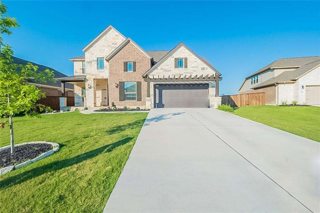Built in 2019, this Liberty Hill two-story home offers quartz countertops, and a two-car garage.