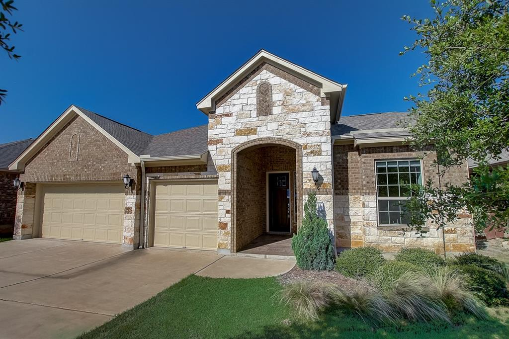 Built in 2017, this Leander one-story home offers granite countertops, and a three-car garage.