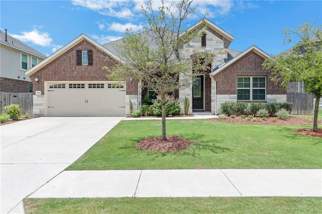 """Stunning single-story with four bedrooms in the intimate community of Concord at Brushy Creek. Striking curb appeal invites you to come inside. An open floorplan once you come through the entry hallway. Spacious kitchen and living room with large dining area. In addition to a formal living, you'll have two bedrooms located down the main hallway, one behind the kitchen with attached bath. The owner's suite has bay windows with a view of the backyard. The owner's bath has a garden tub and separate shower, a walk-in closet, and dual vanity with a marble countertop. The spray foam insulation in the attic and exterior walls will help keep utilities to a minimum. The east front-facing orientation is ideal for morning sun and evening shade on front porch. The exterior features extensive landscaping with an automated sprinkler system. An escape to the neighborhood pool and playground is diagonally across the road. This beautiful home is located within proximity of the Kalahari Hotel & Waterpark, Dell Diamond, Old Settlers Park and Play for All Abilities Park, the Brushy Creek Regional Trail, and downtown Round Rock.  Features & Upgrades: Premium lot ( no house built directly across the street ), Master Bedroom Bay Windows, Master Shower Tile / Mudset, Upgraded Elongated toilets, Upgraded full height mirror in Master, Upgraded floor and wall tile in the second bath, Frameless 3/8"""" Glass Upgraded Master Shower Enclosure, Covered Patio, Granite kitchen island countertops/ waterfall edges, Kitchen tile backsplash, Faux wood 2"""", Blinds on all windows, Granite countertops, Tile flooring, Stainless steel Whirlpool appliances, Hood/cooktop single oven microwave with trim kit, Kitchen cabinet upgrade Espresso, Cooktop bump up, Powder bath, Recessed lighting, Fireplace, Upgraded 8' front door, Additional gas drop back patio, Mini blind insert at back door, Garage Door Opener, Sprinkler System."""