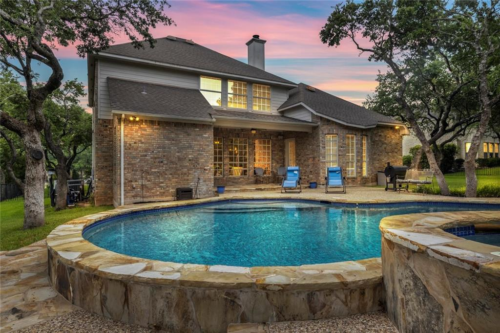 Gorgeous home with an amazing pool! Oversized lot overlooking golf course. 4 bdrm/3.5 bath plus study. Inviting entry with curved staircase and high ceilings. Relaxing front study with soaring windows for lots of natural light. Gourmet kitchen with lots of counter and cabinet space, granite countertops, center island with cooktop, double ovens, & separate wet bar area. Open to dining area and family room. Great entertainment space with large windows looking out at pool. Master suite down with dual vanities, garden tub, separate shower, & walk in closet. Gameroom & 3 spacious bedrooms upstairs with 2 full baths. Outdoor oasis with lots of mature trees, sparkling pool and hot tub, & additional green space. Great RRISD schools!