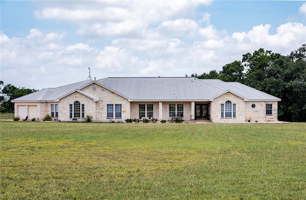 This pristine, gorgeous, custom built ranch style home sits on a peaceful 8.15 acres.  Upon entering, you will find a tranquil feel to this lovely home.  As you enter the home,  there is a living room with a fireplace, formal dining room and the kitchen located to the left side of the home.  The open living room and beautiful gourmet kitchen and dining area boast full walls of windows, French doors to the open-door patio and pool area. Enjoy the 5 ft sports pool with the fountain and waterfall.   To the left the kitchen area is an extra living area, great for a TV room, game room etc.  The secluded primary suite looks out the inviting outside and has a luscious master bath with a walk-in shower. The primary bathroom has double vanities, large walk in closet.  There is a bonus room with the primary suite that leads out to the back patio.  Could be used as an office, exercise room, baby room.   Down the hall form the primary suite is a guest room, nursery, office with a full bath.    Additional bedrooms are across the home and  a share bathroom with two separate vanities and shared tub. For all your toys, to the left of the home sits a 30x50 workshop to store your boats, cars, motorhomes, etc.  For those of you who have a green thumb there is a fenced in garden area and a 40 Ft x 100Ft fenced kennel area. Located east of Walburg the road ends at the drive of this home.  Come and sit on the patio pool area and watch nature among the mystical outdoors.