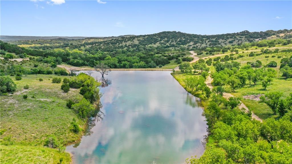 The Ranch lies in scenic Blanco and Kendall Counties, centrally located between Austin, San Antonio & Fredericksburg. We believe this is some of the finest real estate the Texas Hill Country has to offer. At the center of this ranch is a series of water features with continuous water, over 1/2 of a mile long, featuring two prominent impoundments along a spring-fed creek that runs north-south through the property. These water features are extremely private being situated in the center of the ranch. There are 2 structural concrete crossings to ensure reliable all-weather access across the creek. This is the most recreational sound piece of real estate on the market today with 4 bodies of water that should exceed 12+ surface acres. The terrain has a beautiful roll and is loaded with Live Oak, Native Pecans, loads of Walnuts and has scenic meadows meandering through the tree cover on the hilltops. The areas around the water features create a private, park-like feel. The elevation ranges from a low of 1,600 to 1,850 at the summit of multiple peaks on the ranch. These monstrous views coupled with world class water features, wildlife, and idyllic terrain makes this the Pinnacle Ranch of the Texas Hill Country with no other offering of its kind available in the marketplace.