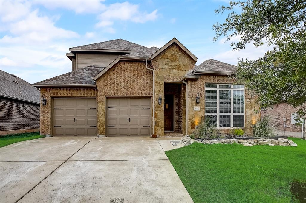 Built in 2016, this Leander two-story home offers granite countertops, and a two-car garage.