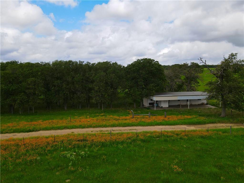 14.55 acre tract with older mobile home that needs some TLC. Electricity is connected, seller extended a water line so new buyer could tap into and get a water meter.