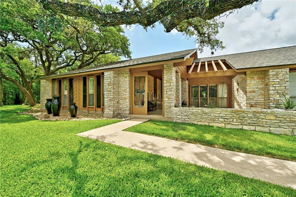 This four bedroom/two bathroom 1.467 acre homestead rests on a quiet street just outside of Austin in Manchaca, Texas.  You won't believe the updates the owners have made to this home!  The owner's suite bathroom has been completely remodeled - heated marble floors, a soaking tub, separate walk-in shower and dual vanities.  The owner's suite also features a large walk-in closet/dressing room.  The kitchen features stainless appliances (all appliances convey) and a deep stainless farmhouse sink complete with chef's sprayer handle.  There's plenty of room for entertaining in the back yard oasis, which includes an in-ground pool (new pump this year), plenty of patio space and an outdoor fireplace.  The 60' barn has a covered porch which leads to the Man Cave.  The Man Cave has a living area, a dining area, a full length bar, and a full bathroom.  There's plenty of room for storage in the barn with dual rolling (motorized) doors.  The roof was replaced in March 2021, HVAC replaced in 2018, well pump replaced in 2020.