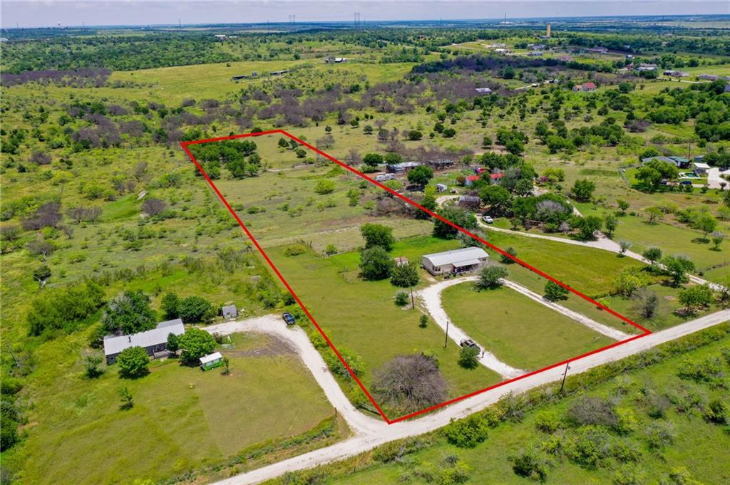 Great opportunity to own some Unrestricted acreage. 20 miles outside of Austin in Kyle TX. No flood plain. 1566 sqft manufactured home currently sits on property, Quiet setting and surroundings.
