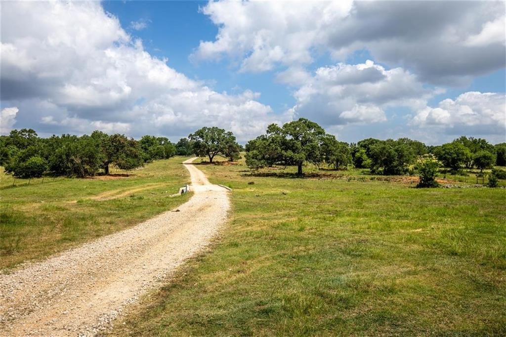Arrowhead Oaks Ranch is a gorgeous ranch with majestic Live Oaks, 240 feet of frontage on Hwy 46, long-range views, and multiple building sites with privacy from the highway.  This property could serve as a homestead, multi-use facility, or recreational getaway, conveniently located 8 miles from Hwy 281 and 15 miles from I-35. Less than 30 minutes from New Braunfels, San Antonio, Canyon Lake, Gruene, and the Guadalupe River. With such proximity to shopping, recreation, and culture, the possibilities are endless.   The 49.0246 acres is a savanna-like pasture, with the dominant tree species being Live Oak.  The lowest point in elevation on the property is along the Hwy 46 frontage.  A recently improved all-weather road leads to the current home and multiple build sites, which is not visible from the highway.  This elevation change provides multiple long-range views and serves as a buffer from road noise.  There is a tributary of Dry Comal Creek that traverses the upper part of the property. The tributary's dense canopy cover and underbrush serve tremendous travel corridor and bedding area for wildlife such as Whitetail Deer. A modest 1B/1B Barndominium and two-car garage can serve as temporary lodging while building or future guest quarters.  It has approximately 800sq. ft. of living space. This home is fenced out for livestock and is nestled under a picturesque Live Oak.  The property is perimeter fenced in good to fair condition and is holding the livestock.  The home is serviced by a private water well which is believed to be 425' deep.  Canyon Lake Water Supply, the primary water supply for the area, has several lines in the region with expansion on the horizon.  Electricity is provided by New Braunfels Utilities and enters the property from the NW corner.  A septic system serves the house.   Surface sale only; Seller owns no minerals to convey. The property is currently qualified under the Agricultural tax valuation via livestock grazing.