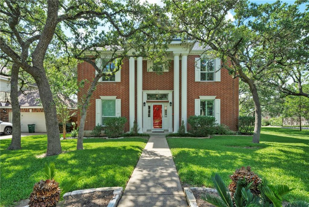 Lovely traditional red brick home on private, corner lot with gorgeous oaks in highly desirable Jester neighborhood! You won't want to miss this home.  Features include hardwood floors (no carpet!), master bedroom down with gorgeous updated master bath including walk in shower and tub, updated kitchen, and spacious family room with fireplace.  Buyers will love sitting on the back deck and enjoying the peaceful, treed yard w/hot tub.  Other features include plantation shutters, private wine closet, breakfast room, and formal living and dining.   Fabulous neighborhood with tennis courts, club house and pool.  Located in AISD with highly desirable Anderson High School.  Convenient location near 2222, 360, MOPAC and 183. This home is updated and ready for move in! A Gem!