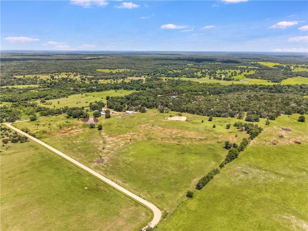 Beautiful 33-Acre Ranch in Rockdale! This property is fully fenced with a pond. Electric and water available. Septic tank on property but needs inspecting. Build your future home! It is currently used for grazing cattle and is AG EXEMPT. The pasture has some established coastal grass that needs attending. There is a concrete slab from a previous workshop that could possibly be used for a barn or shop. Centrally located to several major cities. Approximately 65 miles to Austin, 57 miles to Bastrop, 45 miles to Elgin, 41 miles to Bryan/College Station, 132 miles to Houston, 156 miles to San Antonio. Mineral rights and groundwater rights do not convey.