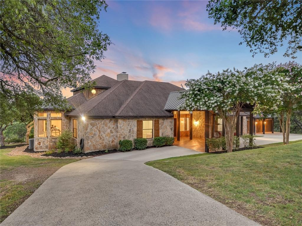 NEW LISTING NEAR WIMBERLEY TEXAS! MAKE THIS LUXURY HOME AND GUEST CABIN WITH SWEEPING VIEWS AND SUNSETS ON 21+/- ACRES SURROUNDED BY MAJESTIC OAKS AND OPEN SPACES YOUR HAVEN IN THE HILL COUNTRY!  (4 or5/4/3 MAIN HOME W/4207 SQ.FT. – GUEST CABIN IS A 2/1 W/957 SQ.FT. - short term rentals okay for cabin as per deed restrictions) THIS CUSTOM HOME OFFERS EXQUISITE CRAFTSMANSHIP, DESIGNER AESTHETICS, AN OPEN & FLOWING FLOOR PLAN W/SOARING CEILINGS AND FANTASTIC NATURAL LIGHT! SPACIOUS GOURMET KITCHEN FEATURES BUILT-IN THERMADOR APPLIANCE PACKAGE, HIGH LEVEL GRANITE COUNTERS & BUTCHER BLOCK CENTER ISLAND W/COPPER FARMHOUSE SINK & CUSTOM CABINETS! MASTER BEDROOM SUITE INCLUDES SUMPTOUS MASTER BATH W/JETTED TUB, SEPARATE WALK-IN TRAVERTINE SHOWER W/DUAL HEADS, EXERCISE ROOM PLUS HIS & HER CLOSETS! GATED ENTRY & PROFESSIONAL LANDSCAPING! ABUNDANCE OF WILDLIFE! AG EXEMPTION! WINDMILL! LOCATED IN THE HEART OF THE HILL COUNTRY BETWEEN SAN ANTONIO & AUSTIN! JUST MINUTES TO WIMBERLEY, HISTORIC GRUENE HALL & CANYON LAKE - A PREMIER BOATING & RECREATIONAL AREA! GREAT OPPORTUNITY!