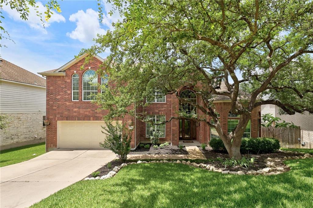 Nestled under a park-like canopy of mature live oaks, this four side brick two-story rests on a .303 acre landscaped lot that backs to greenbelt. The home stretches along the gentle slope with an XL pool and spa plus a sprawling deck & patio, an extensive outdoor living space designed specifically to capture amazing sunsets. Built by Pulte, this lovely home is spacious & bright and has been updated considerably, something easy to note as soon as you enter. Striking hardwood flooring runs through the lion's share of the downstairs & interior paint colors have been updated to contemporary tones. Within the living space you will find vaulted 20' ceilings, a gas fireplace, & a wall of windows overlooking rolling hills and the outdoor oasis. Inside the large, gourmet kitchen you will find white painted cabinets, stainless steel appliances, center island & breakfast bar. The kitchen is open to the living and breakfast room, and all have wonderful views of the pool and greenbelt.     The good sized Master bedroom has a bay window which also looks out on your private oasis. A master bath retreat comes complete with dual vanities, marble counters, a soaking tub and stand-up, fully tiled separate shower. At the front of the home you will find an office space w/ french doors, perfect for working from home. As you wind your way up the stairs, note the iron balusters & catwalk open to downstairs. There are 4 bedrooms and a gameroom up, w/ 2 beds connected by a jack and jill bathroom on one side, and 2 others with a hall bath on the other.   This home is designed for outdoor living, with an outdoor kitchen and fireplace built into the patio level as well as a composite deck with iron railings that is perched for picturesque views. With the XL pool and spa, and generous backyard space enclosed by iron fencing, as well as a gate to the greenbelt where you can explore the wet-weather creek, a perfect spot to spend the evenings with family or friends or simply unwind w/ nature.
