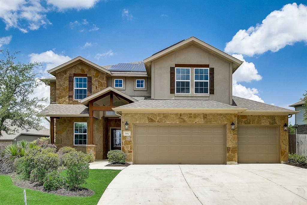 Built in 2015, this Round Rock two-story home offers granite countertops, and a three-car garage.
