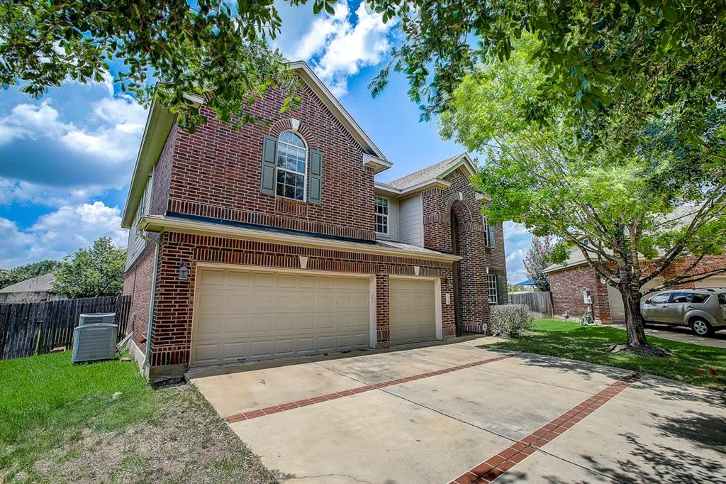 This Pflugerville two-story cul-de-sac home offers granite countertops, and a three-car garage.