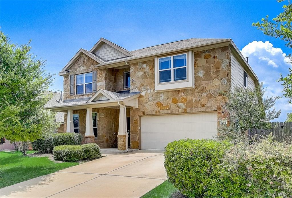 Built in 2013, this Pflugerville two-story home offers a patio, granite countertops, and a two-car garage.