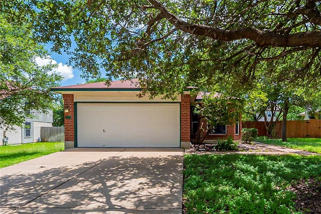 This Cedar Park one-story home offers a two-car garage.