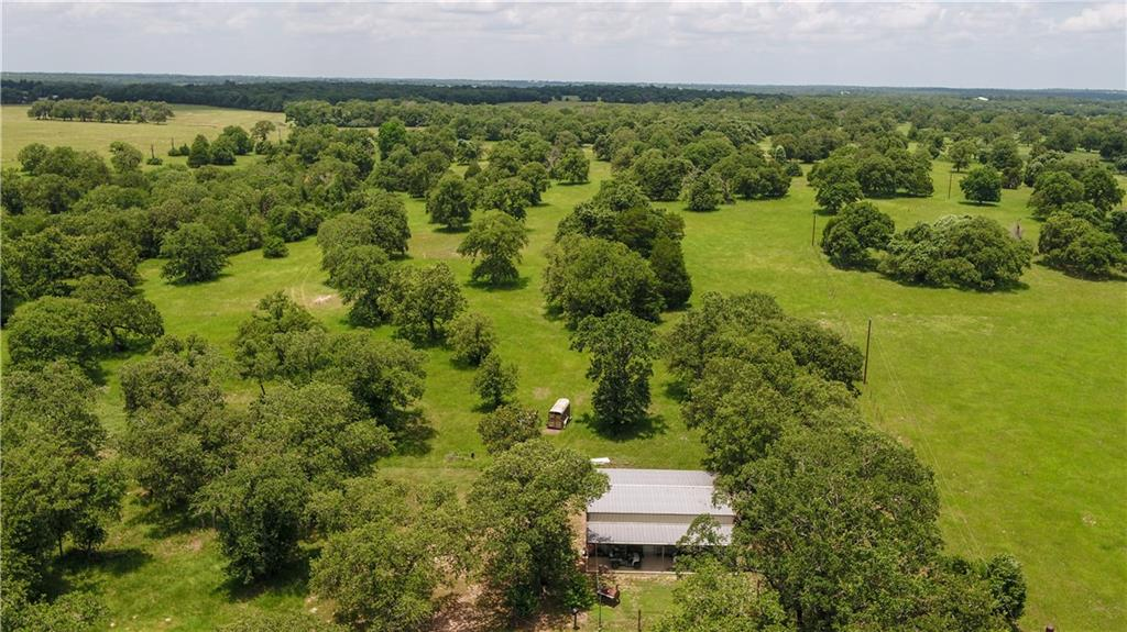 This 183.14 acres property checks all the boxes for the discerning buyers. Its an excellent cattle and hunting ranch and so much more.  This property features a 1,200 square foot barndominium with two bedrooms, one bath and a living/dining area. This barndominium could serve well as a hunting cabin, weekend place or a place to stay while you build new home. There is electricity, propane and 3 water wells, with the additional option to tie into a nearby rural water system.  This ranch is ag exempt and there are cattle working & loading pens, as well as a barn for equipment or hay storage.  There are many thick wooded areas consisting of towering post oaks, elms, cedars and yaupons. Large oaks and some pecan trees dot the open areas creating a highly desirable property. There are several hilltop areas that would be great for a future home, shop or RV spot. The hard work has all been done for you!  This ranch offers phenomenal hunting opportunities with abundant whitetail deer, feral hogs, native predators, small game, waterfowl & game birds. This property has been well- managed for wildlife for over 30 years, with many good, mature whitetail bucks being harvested. Real trophy possibilities here!You can also enjoy many beautiful wildflowers and lots of songbirds too.  For the fisherman, there are 6 tanks, most of which are stocked with fish. Whether youre after bass, crappie, bluegill or catfish, you can find a nice pond to fish. The largest pond is close to an acre in size, with nice, clear water. The ponds are great for recreation, cattle and provide much-needed water to wildlife. Sand Branch is a wet-weather creek that traverses the property, making the perfect place for game to travel and provide varying terrain for the property.   Located in both Williamson and Lee counties.
