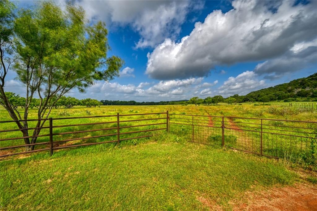 Beautiful Hill Country Ag exempt acreage just outside of Marble Falls! Solar panel ran well provides water for your livestock; this is a rare find and a great savings option. Community water available for your home when you build. Fully perimeter fenced and ready for your animals and new home plans. No build time required. Build your custom home here! Stone Mountain is a gorgeous gated community located just a short drive North of Marble Falls and less than an hour from Austin.  Check out this beautiful piece of land today!!