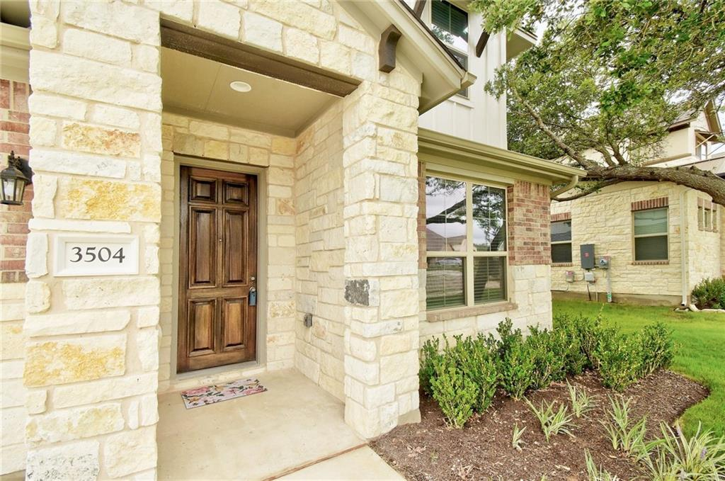 Beautiful 2 story, North facing home with stone & brick exterior and a 3-car garage. The Liberty plan by Milestone was just completed in December of 2020 and has barely been lived in. Built with 4 beds & 3.5 baths, the Owner's Retreat, and guest bedroom are downstairs, with 2 additional beds, a game room and a media room are up.  It is an incredibly open design with high ceilings and lots of storage. The Kitchen includes granite counters, designer tile backsplash, white cabinetry, SS appliances & a center island workspace with SS 1-compartment under-mount sink.  The kitchen is open to the dining and family room. The Owner's Retreat has high ceilings and a luxury bath with a garden tub, split dual vanities, and a separate shower with a frameless glass enclosure.  The Owner's walk-in closet has direct access to the oversized utility room. Upstairs opens to a central Gameroom with powder bath and entry overlook.  The two bedrooms upstairs are linked with a Jack & Jill bath.  The media room is currently set up as an oversized 5th bedroom. The home was built with the extended covered back patio and offers plenty of room for a future pool. Mature trees in the front, and full sod and sprinkler system. Trento includes its own community pool and offers easy access to shopping, dining & recreation.  This one will not disappoint.