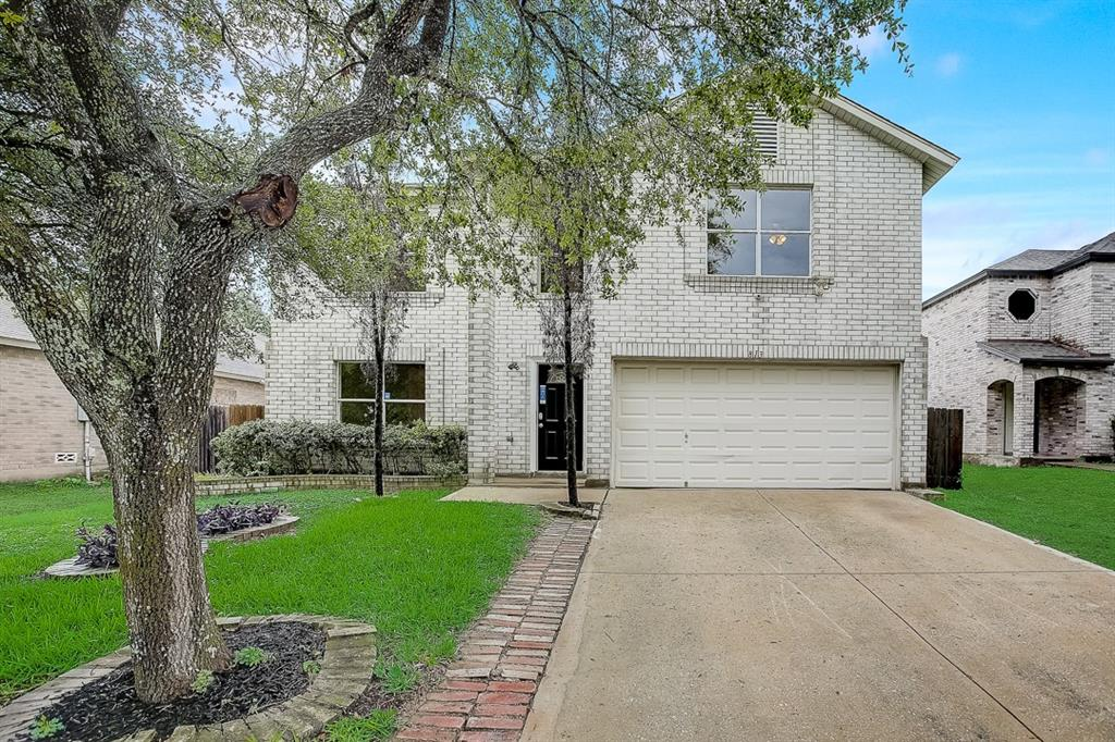 This Pflugerville two-story home offers a two-car garage.
