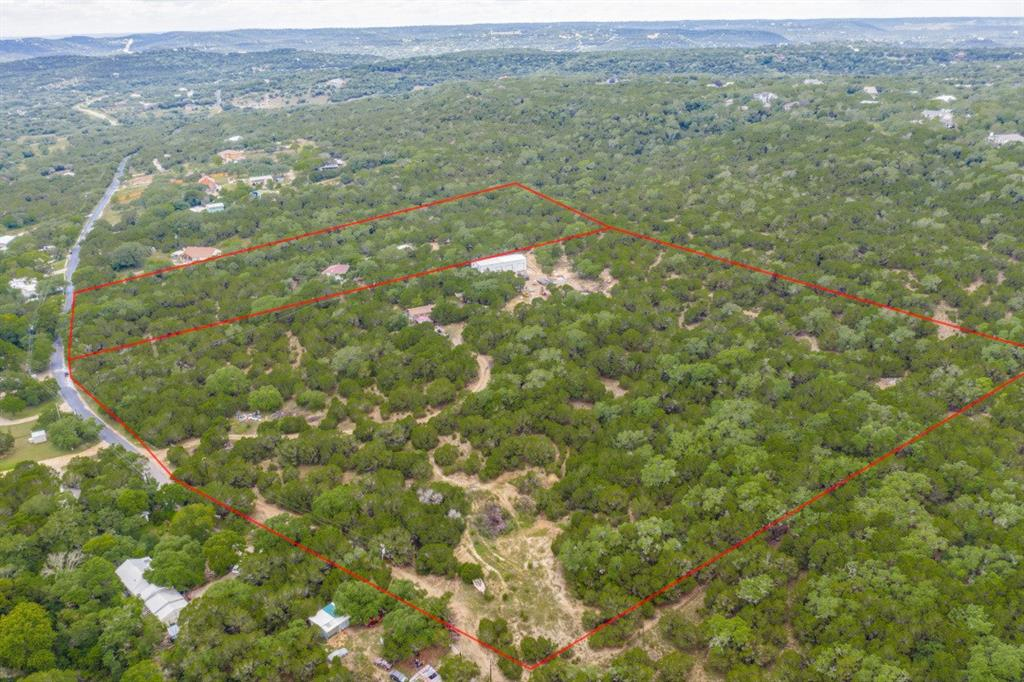 Preferred to sell with MLS#9723918 Total of 19.33 acres approximately!  View Aerial Tour for Lay of the Land! Multiple metal storages! Selling AS-IS. Easy access to 1431! This 14.39 acre lot has phenomenal hill County Views! Fully fenced! Cabin has good bones but needs lots of work. 80x30 metal Storage facility with 2 individual offices within have AC and Electricity, Built 2020! Electricity onsite and Separately metered from 5 acre tract! Water Well installed! Build your Custom Home! Call for more information or a private tour!