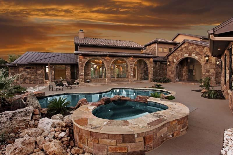Custom-built private residence on gated 20+ acres estate. No corners cut on this spectacular home accessed offHighway 1431. 10 minutes east of Marble Falls and major shopping. This home features incredible finishes and amenities. The main house consists of 4 bedrooms, 2 full baths and 2 half baths with 4,724 sqft. per plans. Includes master on main level with sitting area, study, 2 full kitchens, 2 living rooms and a loft. The casita is 336 sqft. per plans with 1 bedroom and 1 full bath. Generous outdoor living area and amazing pool. The property also features attached 3-car garage with workshop, detached garage/workshop, and detached storage building with RV hookups. The estate is powered by 88 solar panels. Perfect property for livestock, equestrian or for those that want privacy and room to spread out and run around. Currently Ag exempt for lower taxes. Excellent access to major shopping. Also within 10 minutes to all the Highland Lakes, Lake Travis, Lake Marble Falls and Lake LBJ. World-class Horseshoe Bay golf course and waterfront resort is 20 minutes away and also features a 6,000 foot airstrip. Another golf course resort/development is currently planned five minutes from the property. Austin is one hour from the front gate. Buyer to verify square footage.