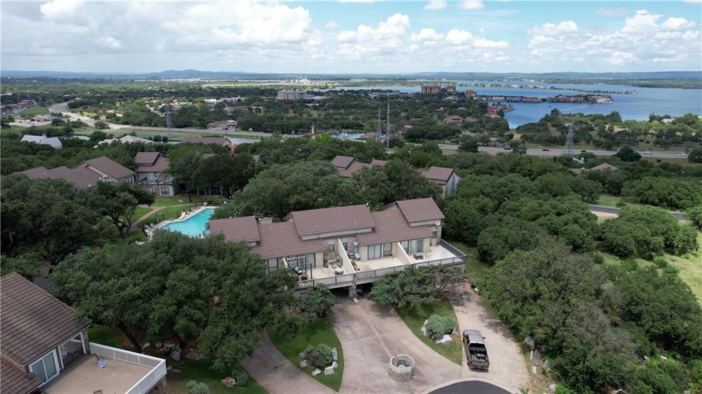 FURNISHED TOWNHOME - SHORT TERM RENTALS ALLOWED Tucked away on a shady hillside, this furnished townhome is the perfect home-sweet-home or home away from home. Enjoy morning sun and Hill Country views on the spacious, upper story deck, where you can catch a glimpse of Lake LBJ.  After an afternoon of pool-side fun, it's just steps to the shade of your covered patio, where you may spy deer lazing under the grove of oak trees. Master suite is conveniently located downstairs. Both upstairs bedrooms have private baths, one offers access to the south-east facing deck and the other access to the north-west facing balcony with a view of the pool.  Living room features soaring, vaulted ceiling with wood-burning fireplace. The Highlands offers well-maintained landscaping, pool, and tennis courts. In addition, property owners in Horseshoe Bay have access to Quail Point, the lakeside homeowners' park, and the Horseshoe Bay campground. Horseshoe Bay is just ten minutes from shopping in Marble Falls, one hour from Austin, and an hour and a half from San Antonio.