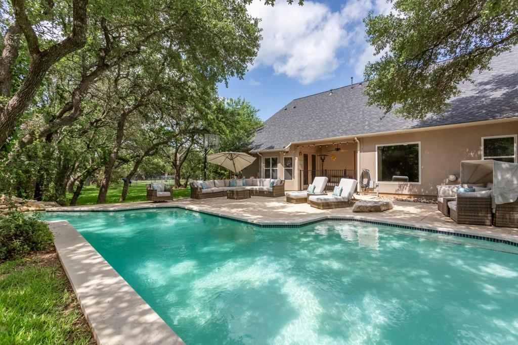 Amenity Overload!! 3 Car Garage, Pool w/waterfall, 900 sf Guest House with Pool Bath - sf NOT included in main house, 1.15 Ac Lot, 2nd drive w/Addt'l Parking for RV/Boat, Fire Pit, Wrought Iron Fencing,Air conditioned Large Storage for Dogs w/Dog Run. This home has a backyard oasis and pool great for entertaining.  Main Home is 4 Bed/2.5 Bath, Large Open Kitchen w/connected Family Room, Foyer opens to 2nd Living with spectacular view of backyard. 3rd Car Bay is Home Gym w/Split AC Unit - work out in style.  No carpet in home - tile thru out house, high ceilings, recessed lighting in kitchen, tons of Storage, Large Secondary Bath w/2 sinks, Large Master Bedroom with oversized Closet, Separate Tub & Shower & 2 Vanities. Recent updates: roof, water heaters in main & guest house, cool deck, pool heater, dog run, dishwasher, recessed lighting, office converted to 4th bedroom. 3rd Car Garage is currently home gym area with split unit AC. In this community you will feel like you are miles away from the city but just minutes to all the conveniences: Wolf Ranch shopping, Randalls/HEB, Historic Georgetown Square. Lake Georgetown with a quiet park, hike & bike trail and public boat ramp is less than a mile away. Highly rated feeder schools in Georgetown ISD**Complete Theatre Room system w/10' TV screen is negotiable.**