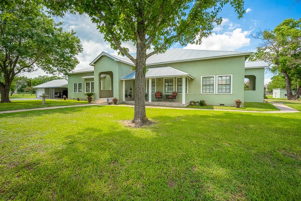 Own a piece of Texas History! This charming historic building was originally built as the Winchester school in the 1930s. Beloved by local families in Winchester Texas, the school was purchased for a private residence in the early 1950s. The large room dimensions make it a lovely home with the open floor plan modern buyers are seeking. With shady porches on three sides, the plaster exterior is architecturally stunning. The updated kitchen features floor-to-ceiling Birchwood cabinets and a Jenn Air range. Adjoining walk-in utility room has an antique wash-sink and room for a beverage refrigerator. High-quality, laminate wood-style floors throughout have the look of vintage floors but are virtually carefree. The master has an en suite bath and two walk-in closets. Secondary bedrooms are large too. Situated on 4.5 acres that's fully fenced with road frontage on all sides and has a 44x60 metal barn with electric, a large lean-to shed, and cattle pens. Whether you want a larger home or space for an event center, wedding venue, or lodging like no other, this rare find charming home in Winchester is your dream come true.