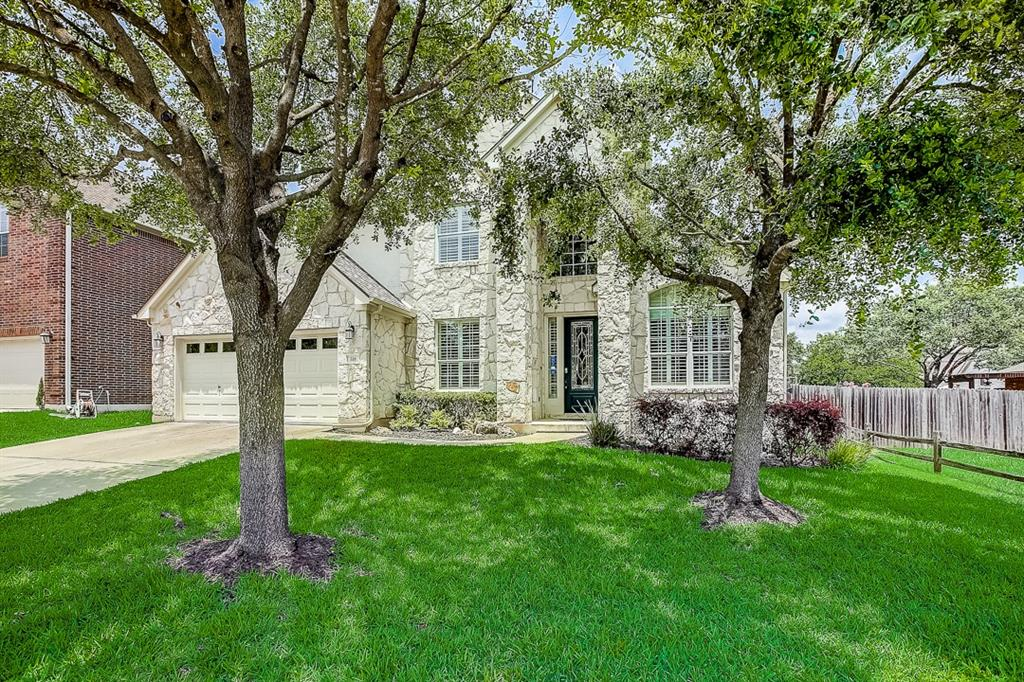 This Cedar Park two-story home offers a patio, granite countertops, and a two-car garage.