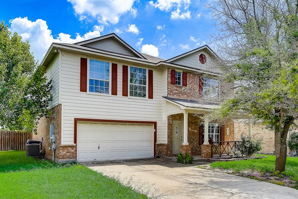 This Hutto two-story home offers a patio, and a two-car garage.