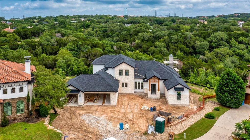 Imagine coming home to your custom built home in Hidden Springs Ranch right in the heart of Dripping Springs and located on this serene property with oak trees surrounding your home. The highly respected and local custom builder, Strobel & Associates, is offering an opportunity to build this floor plan on this 1+ acre homesite or allowing you to design your own dream home. Running Deer Lane has a great location for so many reasons, it is walking distance to the Dripping Springs High School, in the heart of DT Dripping where all the local boutiques, breweries, wineries, new venues, shopping, & restaurants are popping up so frequently, yet it is only about 30 minutes away from DT Austin and 30 minutes from the Austin Airport!  Strobel & Associates has built for two generations in Dripping Springs and the Austin area and has a reputation that a buyer would be proud to say that their home was built by them. **These photos are not the photos of the actual home on this lot.  These photos are of a home built by Strobel & Associates on another lot. This plan will be altered to have a side entry garage per the deed restrictions of the neighborhood. Buyer can build this same plan as advertised OR bring their own plan or change finish-outs.**