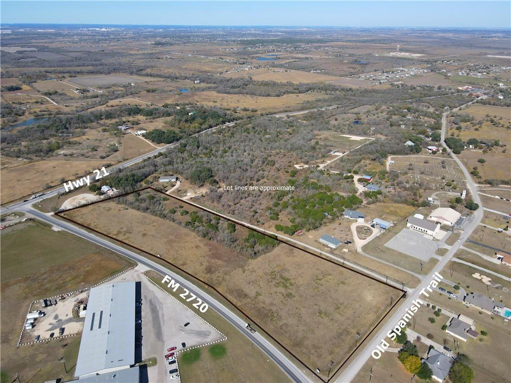 10.43+/- acre commercial tract with located in a high traffic location. Development ready site with dual road frontage on FM 2720 and Old Spanish Trail with approximately 1,650 feet of road frontage. This site is currently zoned General Business with the City of Uhland.  Utilities: County Line SUD service area for water & wastewater. County Line SUD has water lines on FM 2720 & Old Spanish Trail in front of this property. Electricity is provided by Bluebonnet Electric Coop & has 3-phase on the property on Old Spanish Trail. At this time, septic would be needed. However Uhland is growing quickly and this would be great for someone with the patience to wait until sewer is extended to serve this tract.