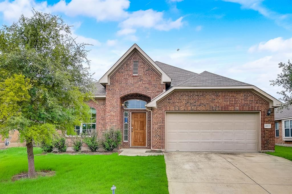 This Pflugerville one-story home offers granite countertops, and a two-car garage.