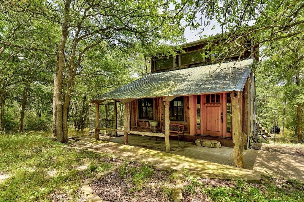 Private Cabin on 17 +/- Acres of natural landscape with varied topography that supports an abundance of wildlife including: Bobcat, Otter, Deer, Hawks, Ducks, & more. NO RESTRICTIONS per Title. Two Ponds & 1 stocked w/ LoneStar Legacy Florida Strain Largemouth Bass, Copper Nose Bluegill & Redear Sunfish from Overton Fisheries. Located approx 30 min to Austin & Tesla for the perfect get away place or primary residence w/ plenty of room to grow or build your secluded dream home. Property is fully fenced incl. a Heritage Post Oak Tree, Dog Invisible Fence w/ 4 Collars & Vegetable Garden. Adorable cabin has a Full Kitchen w/ Granite Countertops, Anderson Windows, Bamboo Floors & 2 Bathrooms. Metal Workshop Building has a Laundry Room w/ AC. Survey Available. Hurry beautiful properties like this don't come up often at this low price per acre. Appointment ONLY, cameras are on the property.