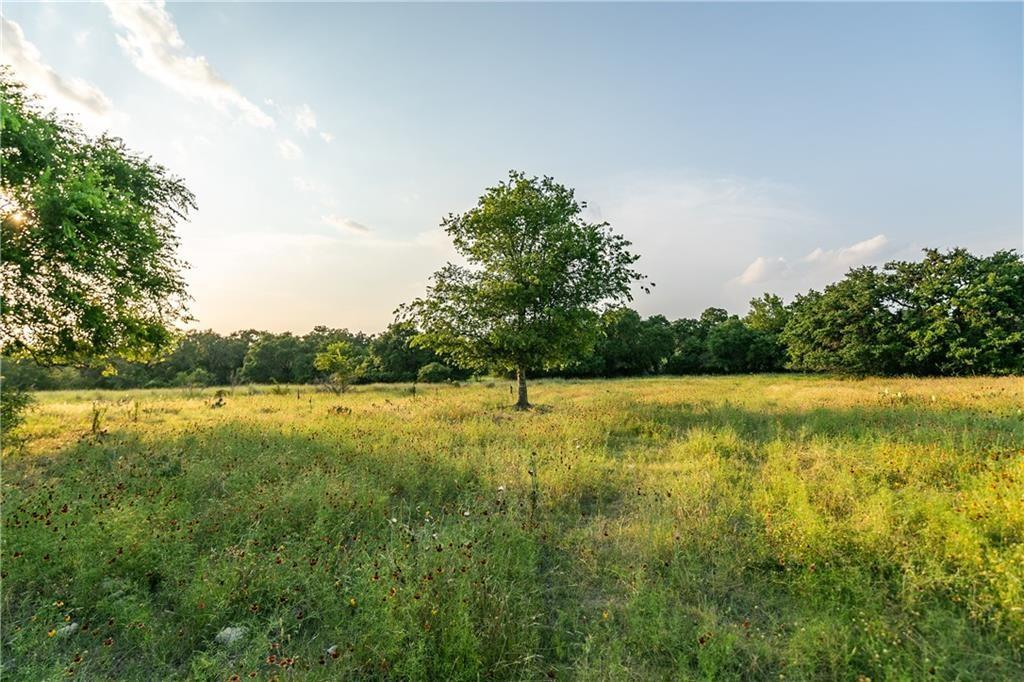 25 pristine acres perfectly located 6 miles to Johnson City in route to Fredericksburg. The ranchland is a good mix of amazing oak groves, a wet weather creek, meadows covered in wildflowers and a large coastal pasture for grazing. The hard wood trees are absolutely stunning and abundant. The access to the ranch is ideal and offers paved frontage on Persimmon Rd and easy access to 290. This property is ready for your enjoyment. The property is partially fenced. This is a fantastic ranch located along the famous wine trail in one of the fastest growing areas in the USA. AG exempt. There are reasonable restrictions