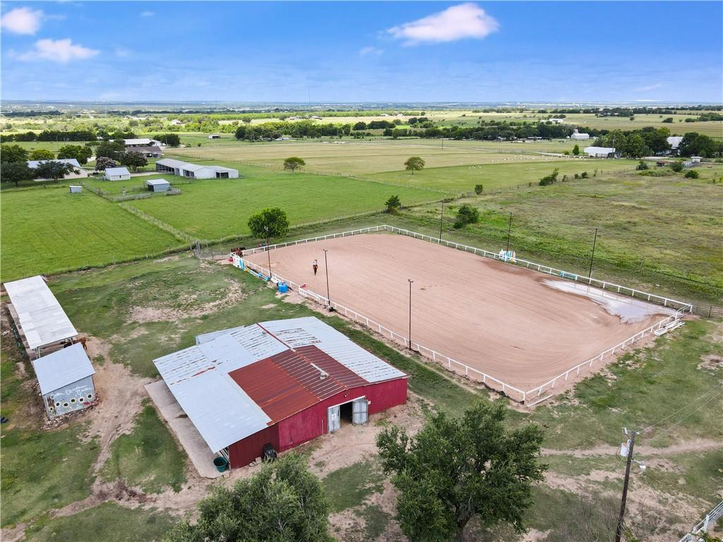Rare opportunity to own a 17-acre Equestrian Center. NE of Georgetown (just ten minutes from downtown Georgetown) makes for great long views from the property. This place is all about the horses so if you love horses, you will love this place. Facilities are Ready for you to take it to the next level.   Property includes a complete 100x200 lighted riding arena, 2 separate barns with 9 stalls each, hay barn, large Tack rooms with lockers, feed rooms, and fly spray systems. Lighted 8 stall grooming/wash station. There are 8 separated pastures fenced and Cross fenced, including shelters, plus a large Pond. Currently 25 horses roam the 17 acres comfortably, many of which are boarded horses, this property is turnkey. For the people, there is a main house, a one-bedroom cottage, classroom with bathroom attached to the main barn and an unfinished apartment over one of the barns. Must go up on the upper deck to get a glimpse of the long view for miles.  So, look no further come get your piece of Texas.