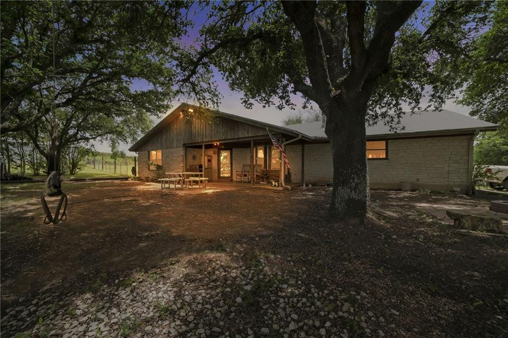 RARE beautiful acreage tract with close proximity to town, amenities and shops. 10.5 acres of well kept land with wet weather creek to enjoy plenty of wildlife and native vegetation including large pecan trees. Beautiful home with two large covered porches, one of which is screened in. The house is surrounded by a variety of large trees that provide plenty of shade and cover. NO RESTRICTIONS OR HOA. Also listed as commercial. It has second driveway on south side of the driveway that is not currently in use. Brand new high-end range. Large oversized living room that hosts a real wood fireplace which came in handy during snowpocalypse. Rolling green pasture, with boundaries marked by trees.