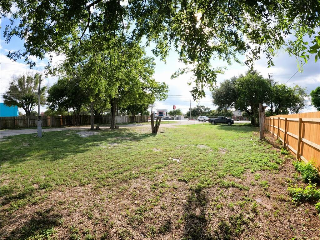 Lot for sale directly behind HEB at FM 1825 and Wells Branch Pkwy in Pflugerville.  It is .89 acres with 91' of frontage on FM 1825, and 431' deep.  Surrounded by many businesses such as restaurants, oil change service, car wash, movie theater, auto parts store, vape shop, upholstery shop, and even a large furniture store.  In Austin City limits and Travis County, utility services through City of Austin, with a Pflugerville address and Pflugerville school district.  Many trees both large and small, completely fenced.  Chain link across the front, privacy down both sides and back of lot.  Houses are tear downs, the light brown house is 3 bedrooms/1 bath, kitchen and utility area with wood siding and floors and ashphalt shingles on roof.  The cabin at far back end of lot is a 2-story loft with 1 bedroom/1 bath, kitchen and utility area with a metal roof, wood decking on floor and wood exterior siding.  Cabin is unfinished on the inside.  There are no kitchen appliances, window units and any heaters do not convey.  Both are pier and beam.  Inside of houses can be seen by scheduling an appointment with Listing Agent.  Great location to build a business.  See MLS #3223492 for land/lot listing.